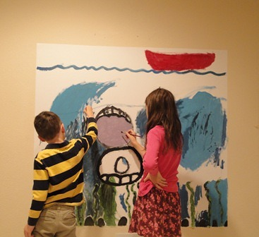 Children painting uprinted Casart wallcovering on Slipcovers for your walls, casartblog