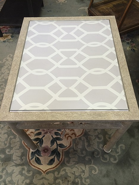 A glass tabletop is easily transformed with Libby Langdon Groovy Gate_Casart reusable wallpaper