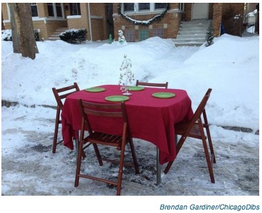 Table and Chairs as snow parking savers on casartblog