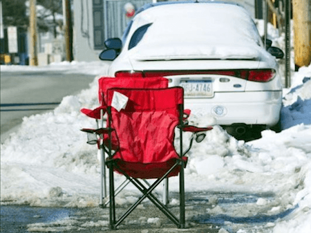 red chair parking space saver on casartblog