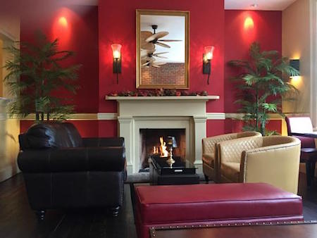 Palm Lounge fireplace via Magnolia's on King_casartblog