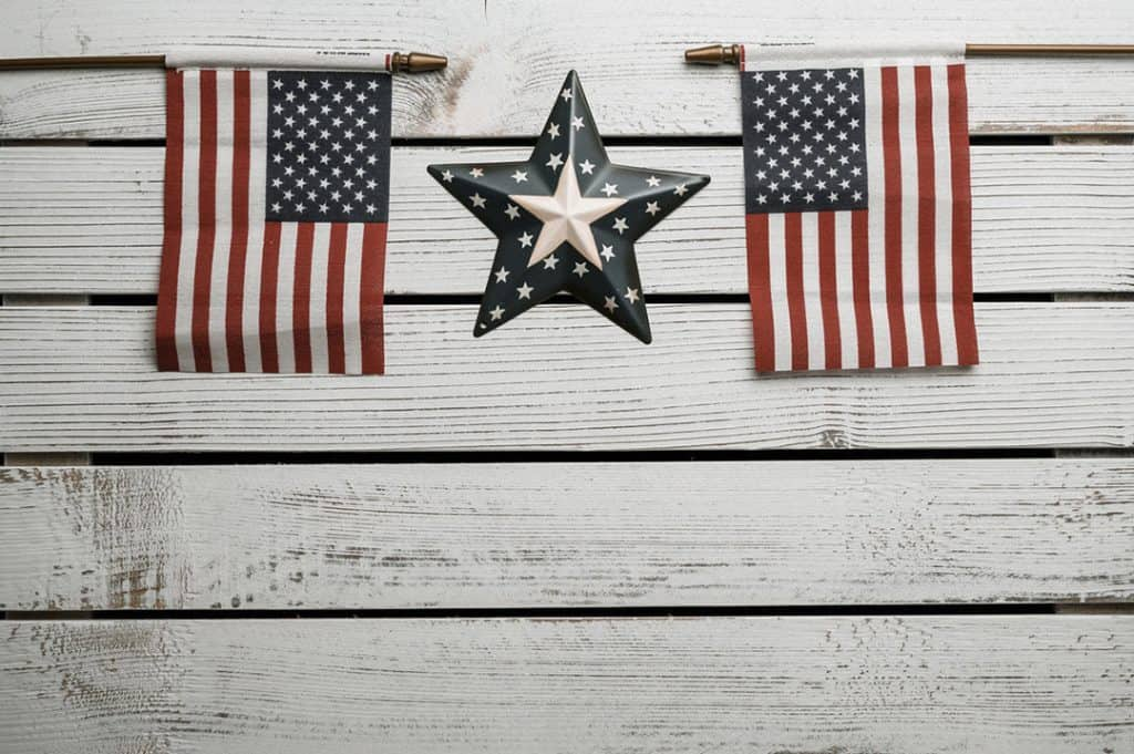 American flags and star on white by Brett Sayles via Pexels on casartblog