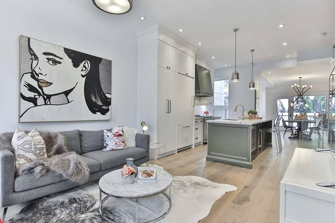 Vintage Art makes modern living room look expensive_casartblog