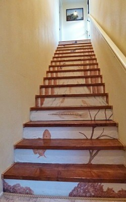 Casart Customer creates spectacular stairwell with Casart Woodland Stream Mural