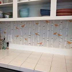 Casart Customer uses self-adhesive birds and birch backsplashes with wallpaper in kitchen