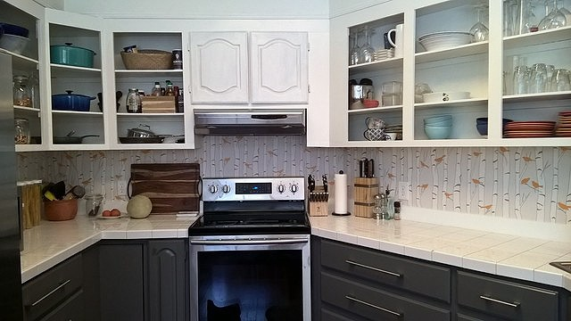 After: Kitchen with some painted cabinetry and Casart wallcovering