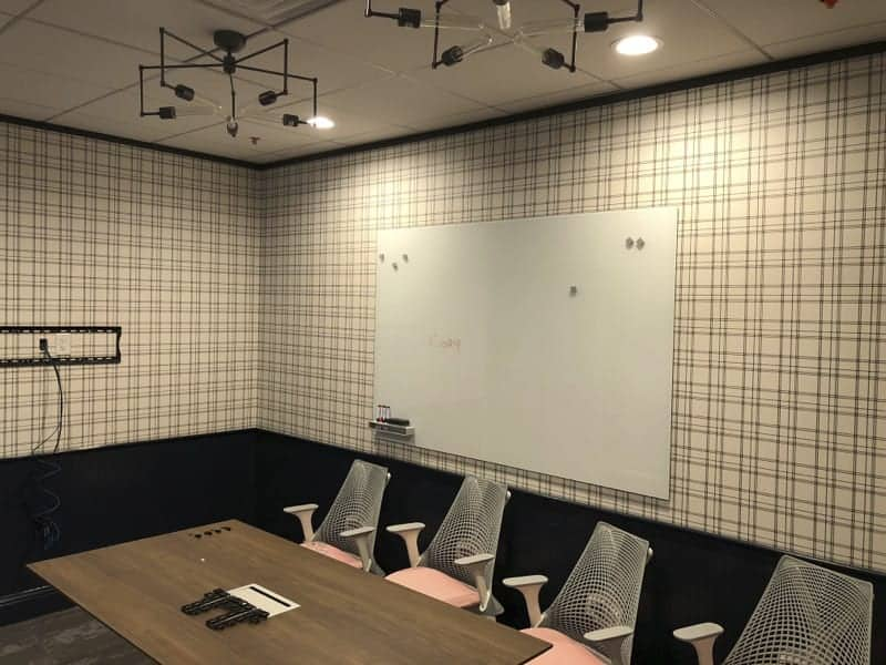 Deauville wallpaper from Galerie Wallcoverings dresses the larger conference room