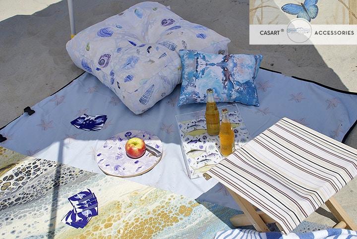 Casart Outdoor Pillow in Shells design on the beach