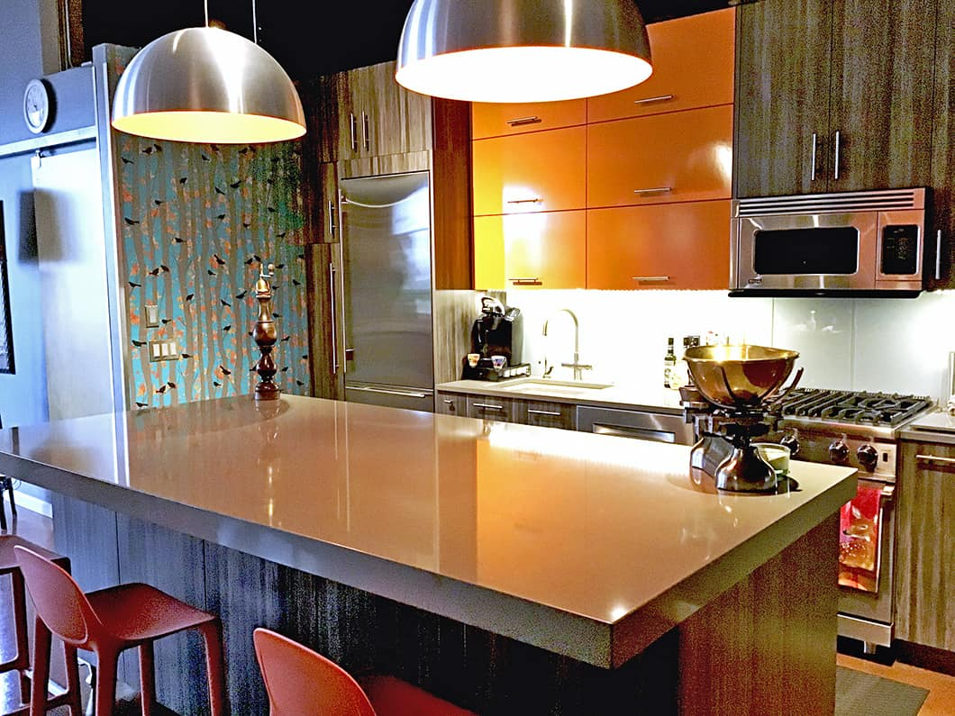 Casart Coverings Bold Birds & Birch repositionable wallcovering modernizes a contemporary kitchen